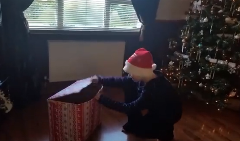This little boy got a little puppy for Christmas after losing his old dog!